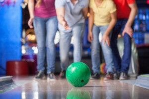 Group of friends bowling. Happy group of friends having fun bowl