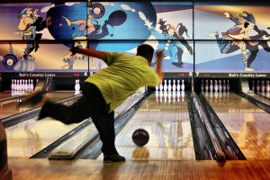 Man throwing a bowling ball at Rab's Country Lanes