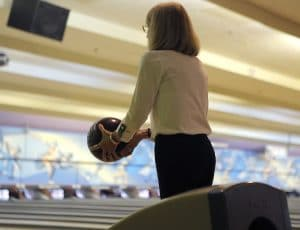 Woman about to throw bowling ball