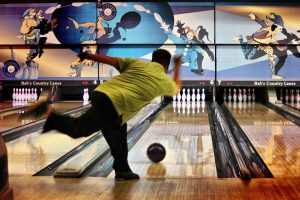 Action shot of man bowling