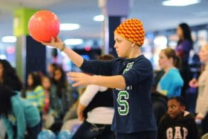 Teen boy about to throw bowling ball