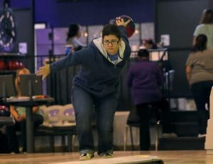 Person bowling left-handed