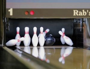 Bowling ball hitting pins on deck at Rab's Staten Island